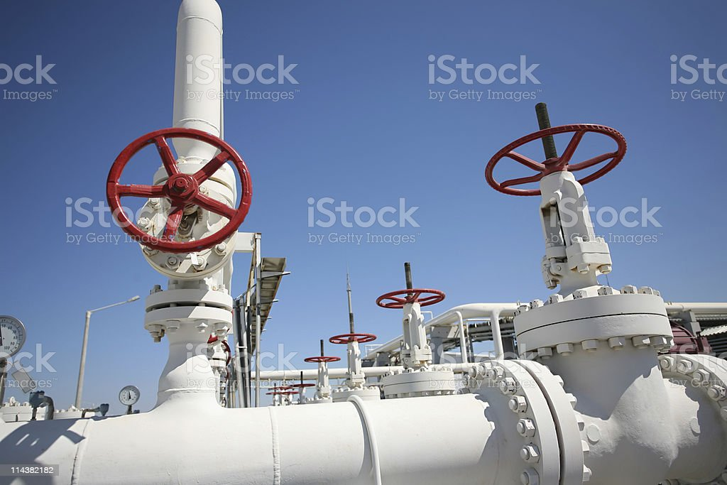 Pipelines and valves in oil and gas refinery stock photo