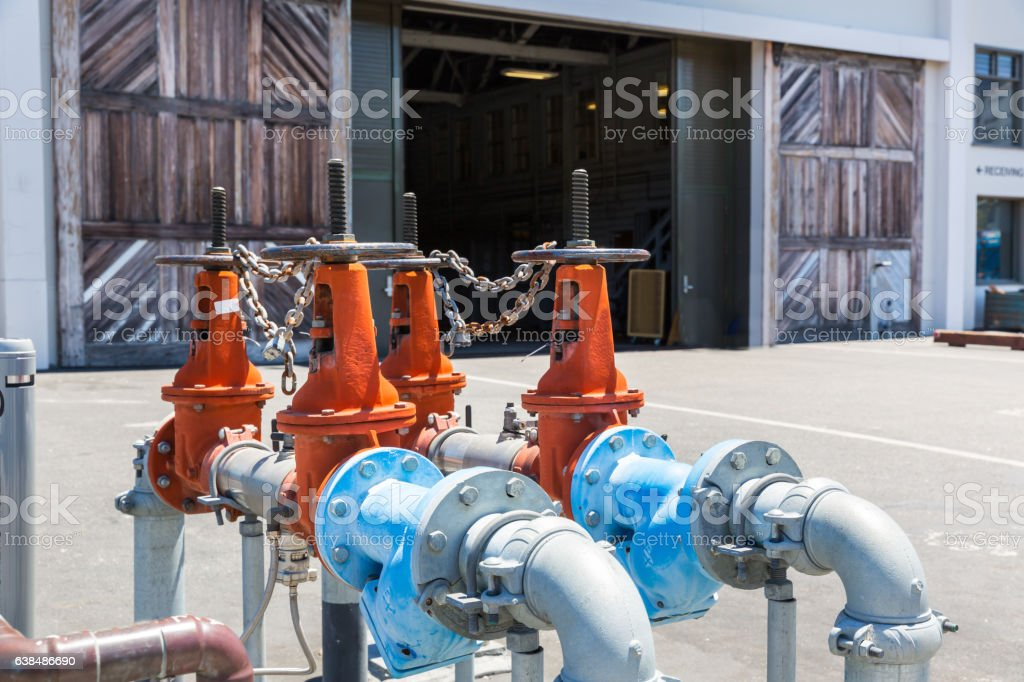 Pipelines, water pump and valves in dock stock photo