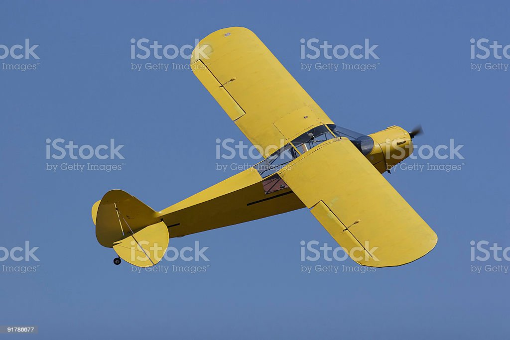 piper cub in blue sky royalty-free stock photo