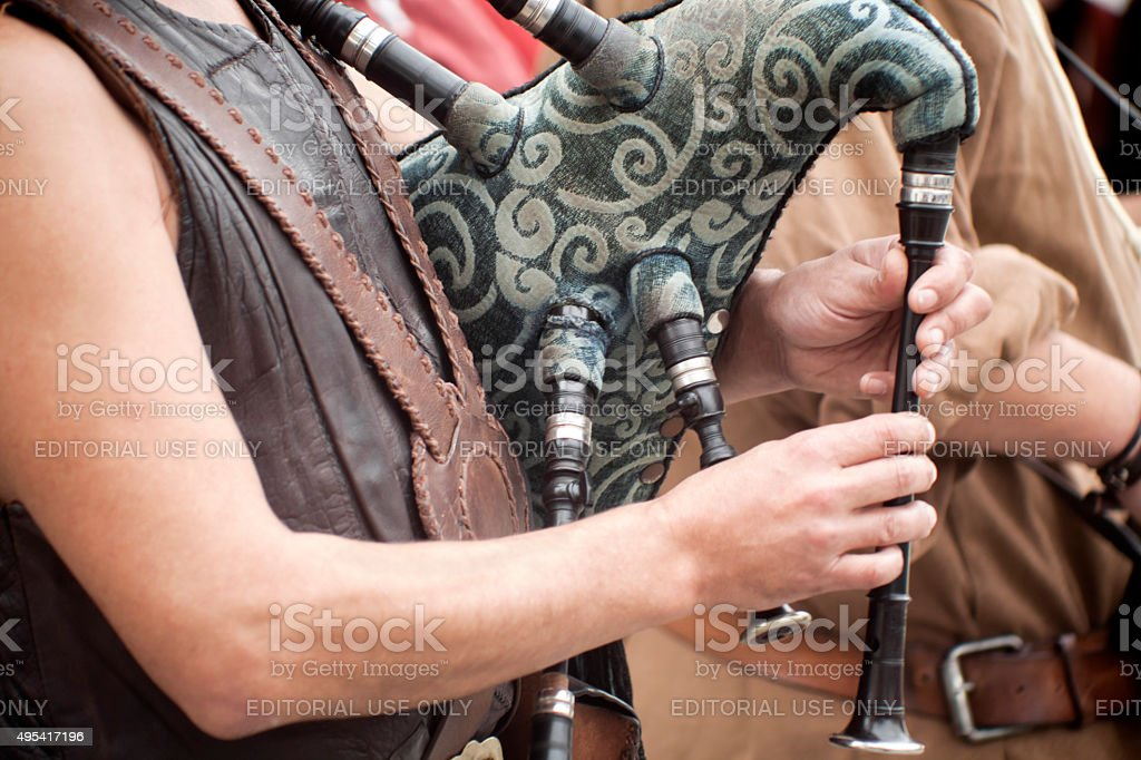 Piper in a street artists folk band. stock photo