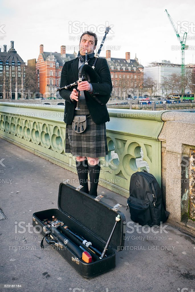 Piper on Westminster Bridge, London stock photo