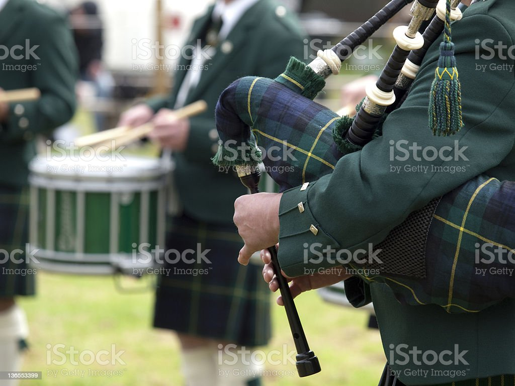 Piper playing in a Marching Band, Scotland stock photo