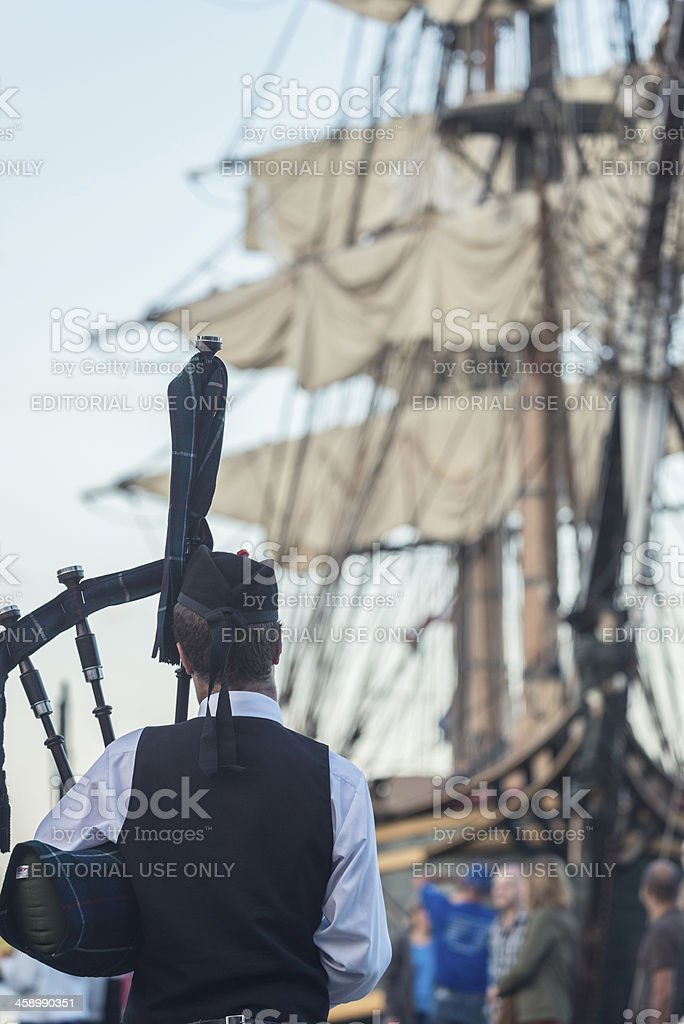 Piper with HMS Bounty royalty-free stock photo