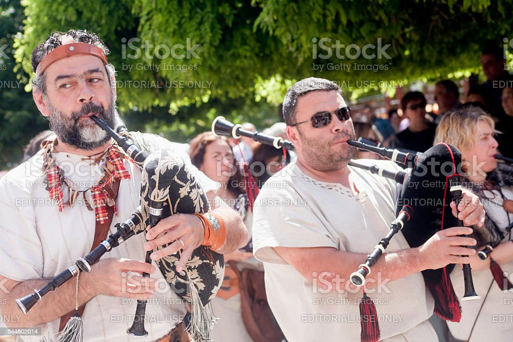 Pipers in a street artists folk band. stock photo