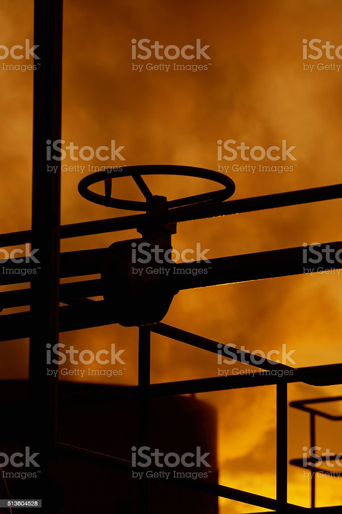 Pipes and valves, silhouette at sunset, Turkey stock photo