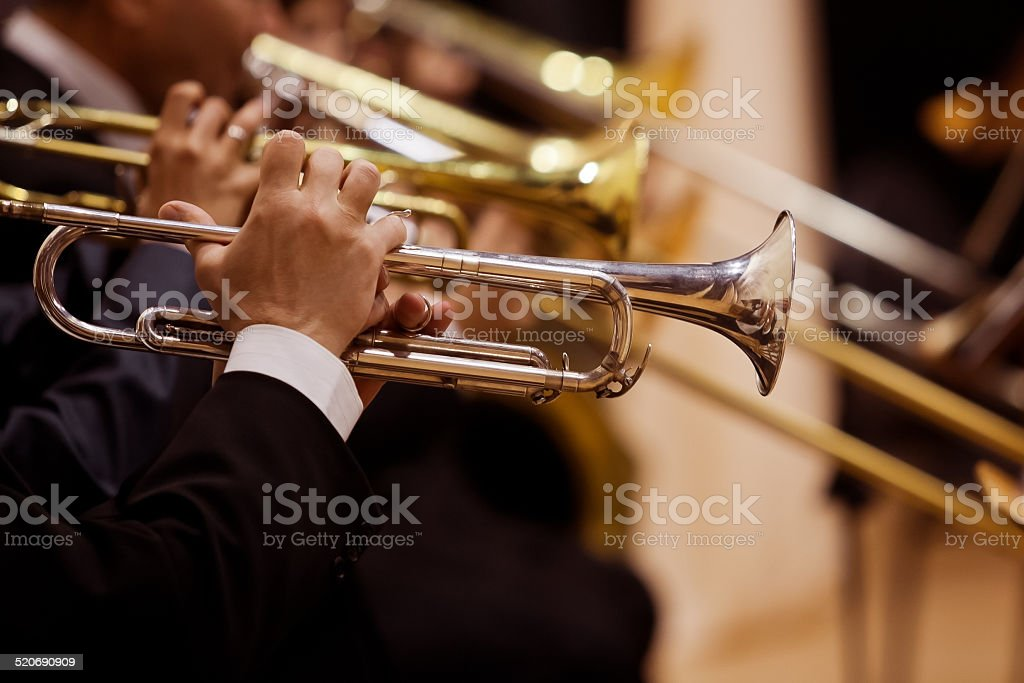 Pipes in the hands of musicians stock photo