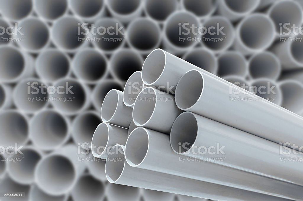 PVC pipes stacked in warehouse. stock photo