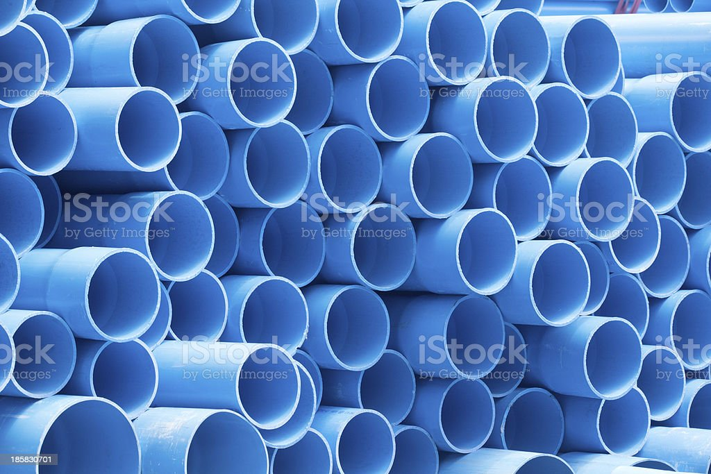PVC pipes staked in construction site stock photo