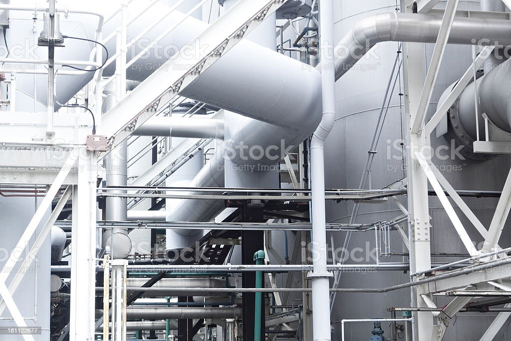 Pipes, tubes, machinery and steam turbine at a power plant royalty-free stock photo