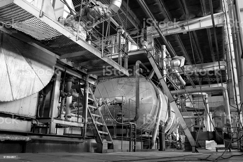 Pipes tubes machinery and steam turbine at a power plant royalty-free stock photo