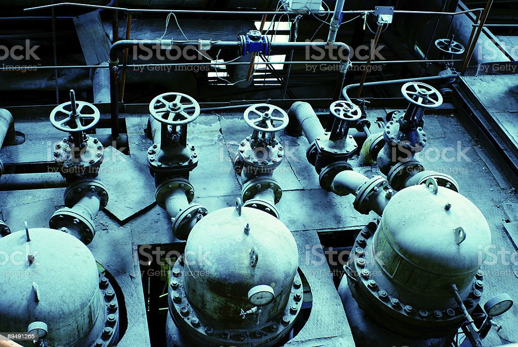 Pipes, tubes, machinery and steam turbine at power plant royalty-free stock photo