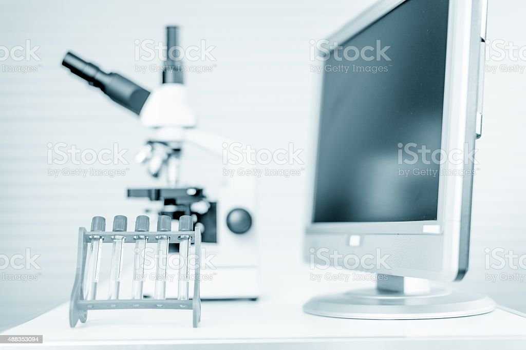 pipette and chemical glass in laboratory blue color stock photo