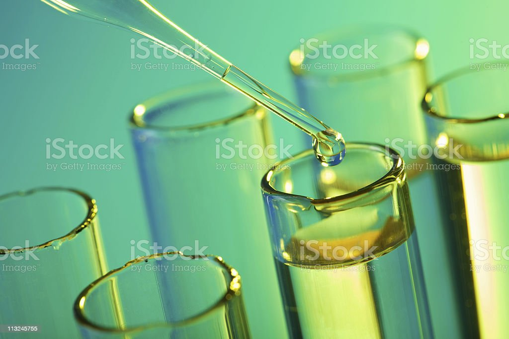 Pipette drops into test tubes science experiment stock photo
