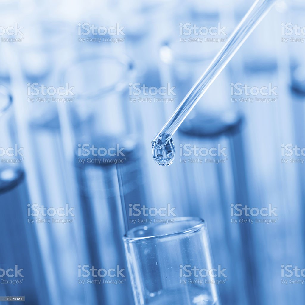 Pipette with a flask royalty-free stock photo