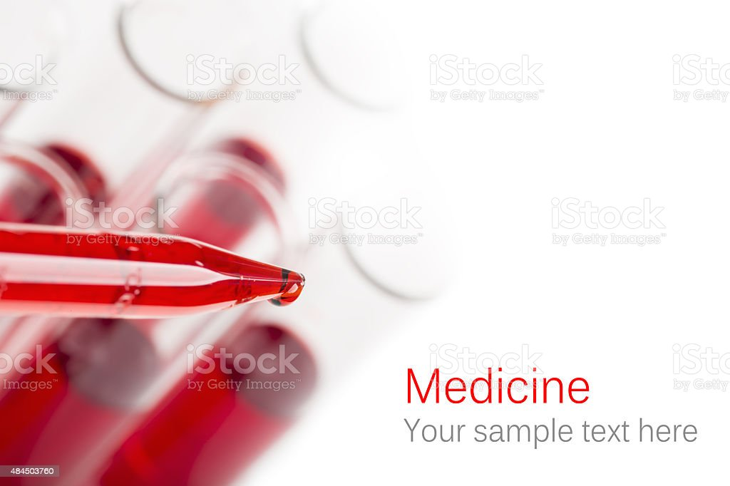 Pipette with drop of blood stock photo