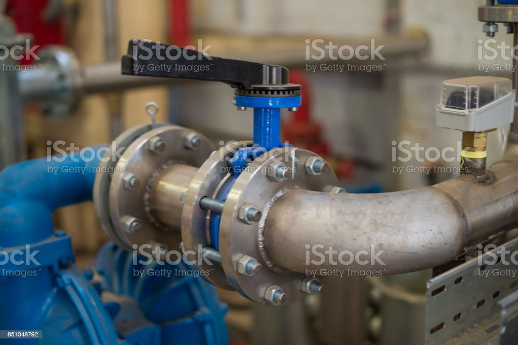 Piping system flanges and slide gate stock photo
