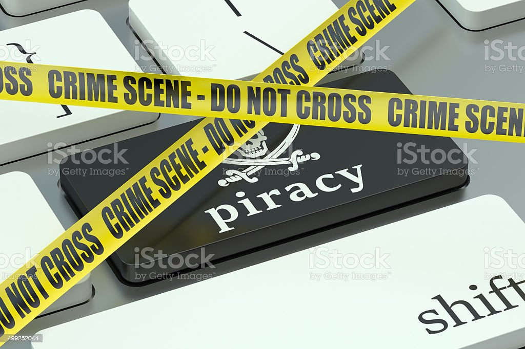 piracy concept, on the computer keyboard stock photo