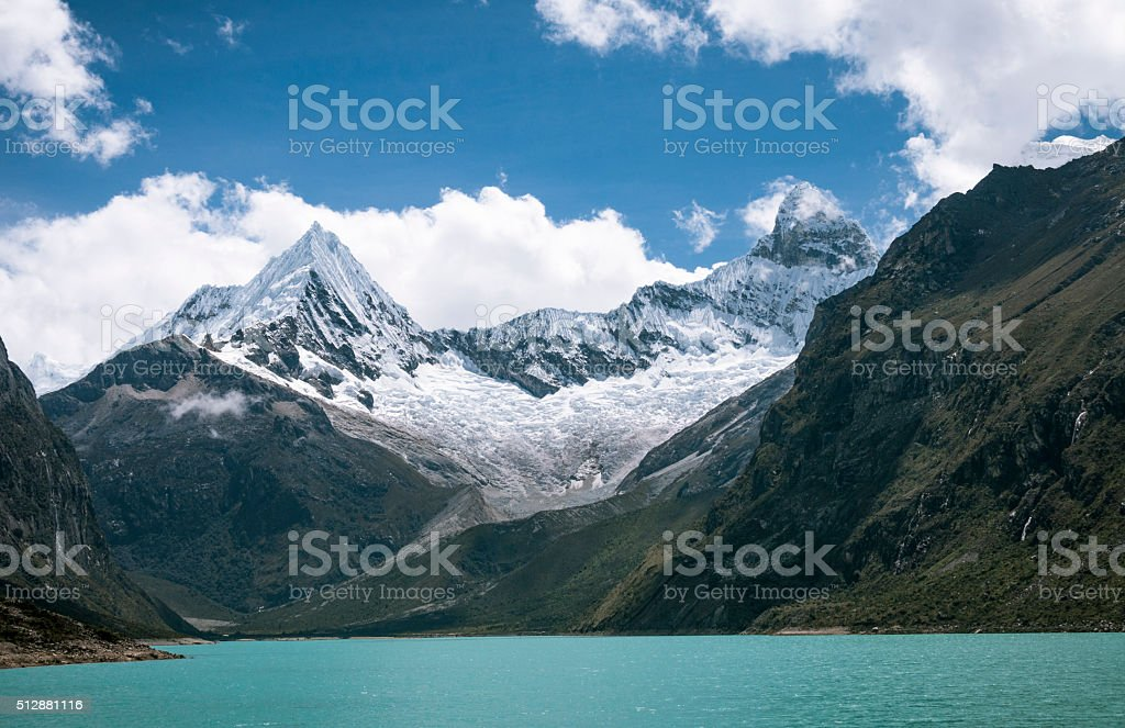Piramide Peak And Chacraraju Behind Lake Paron In Peru stock photo