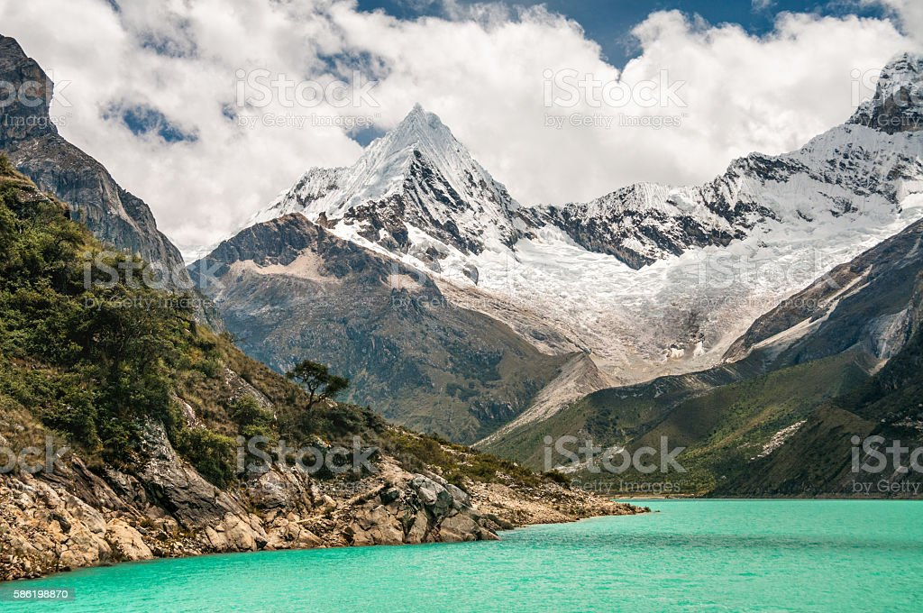 Piramide Peak And Chacraraju Behind Lake Paron In Peru stock photo