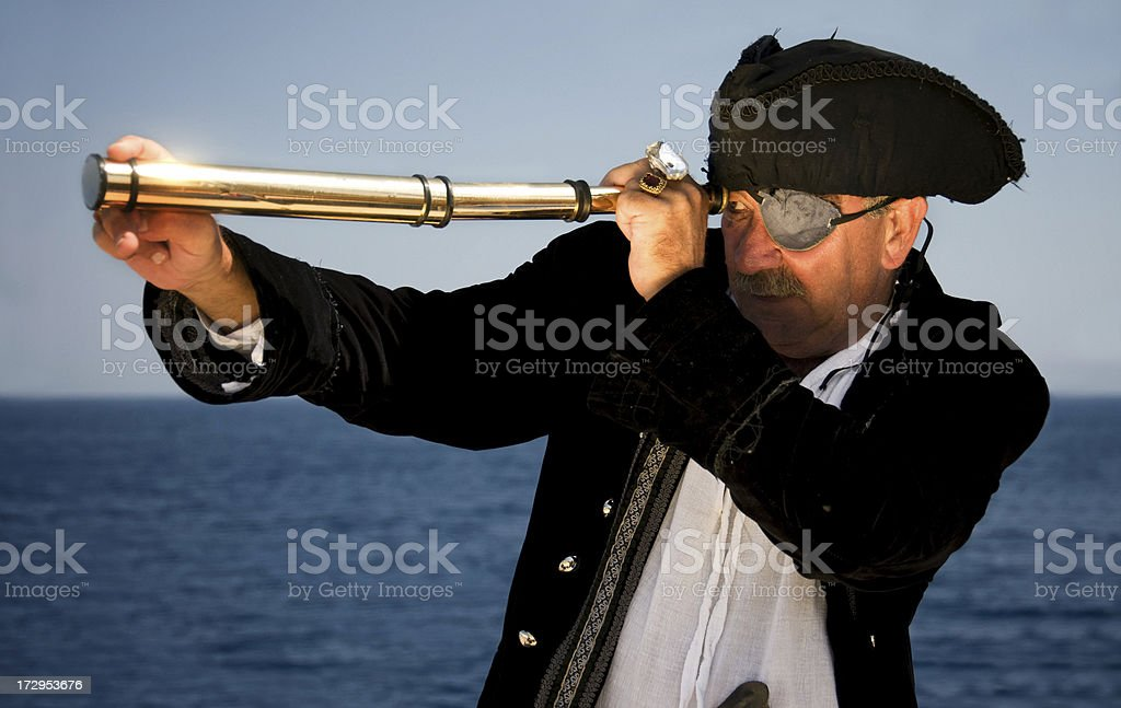 pirate captain looking through a spyglass royalty-free stock photo