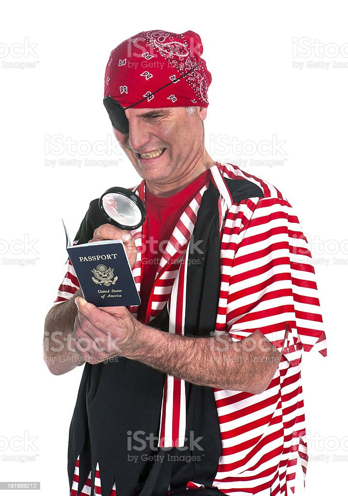 pirate examines U.S. Passport royalty-free stock photo