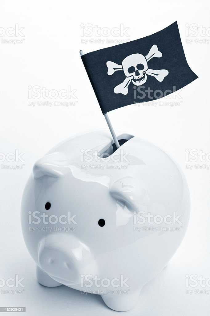 Pirate Flag and Piggy Bank stock photo