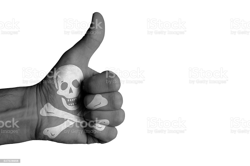 pirate flag on male thumb up hand stock photo