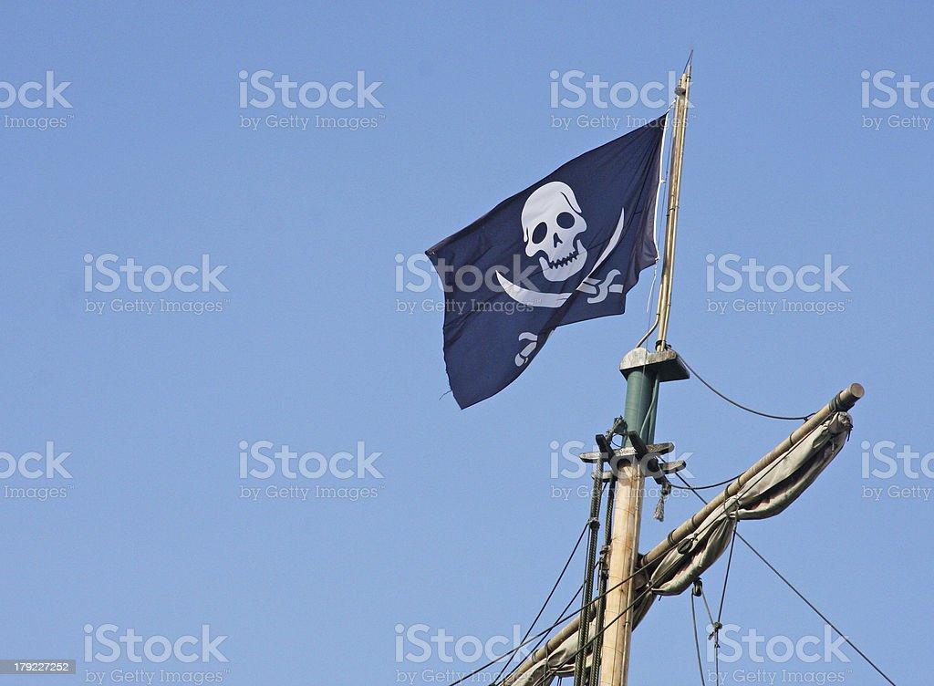 pirate flag that flies above the Corsair ship stock photo