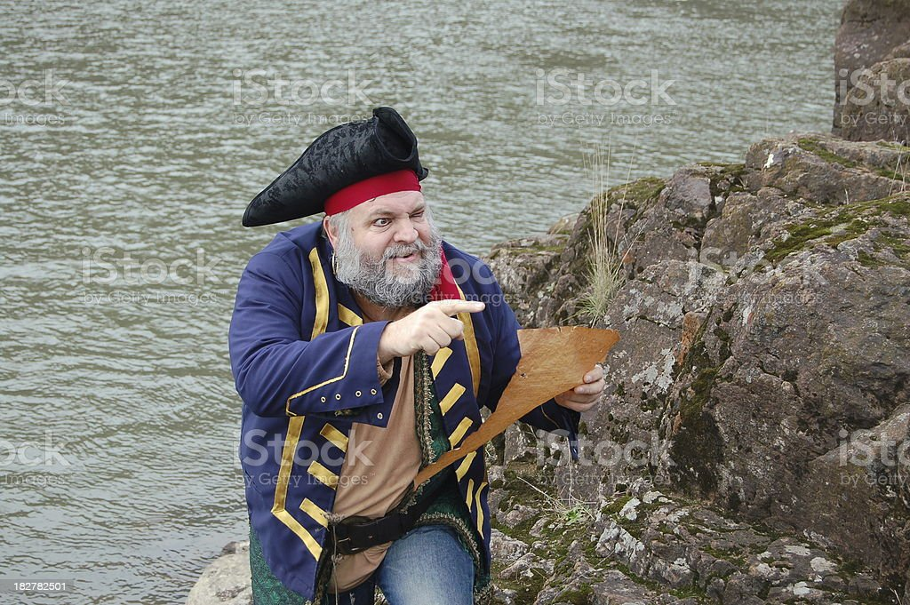 Pirate Guided By Map stock photo