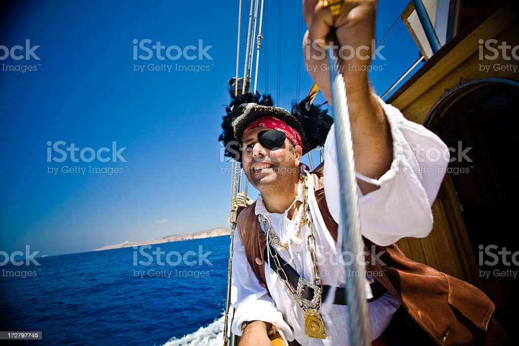 Pirate holding onto a rope stock photo