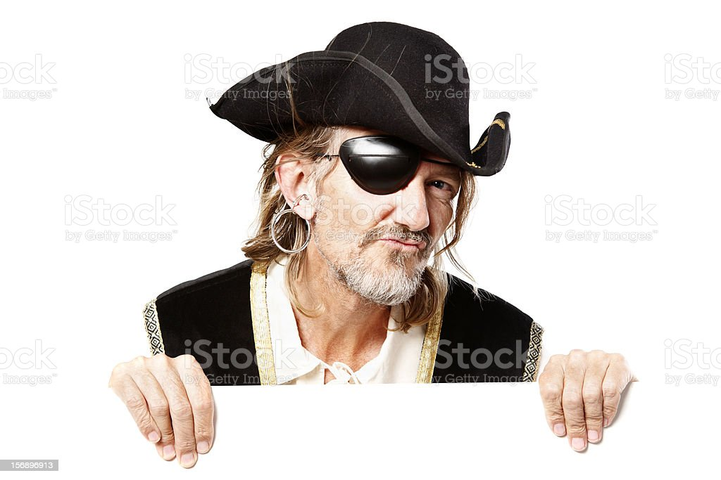 Pirate holds blank board ready for you to add message stock photo