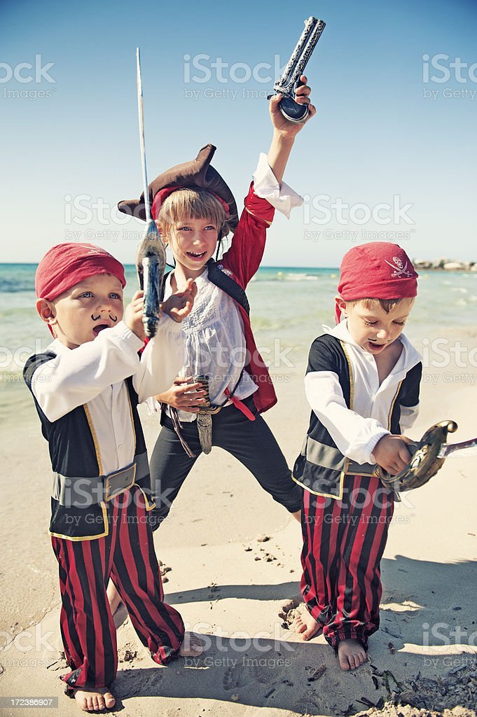 Pirate kids on the beach royalty-free stock photo