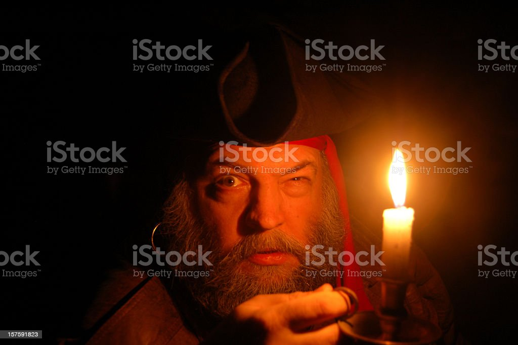Pirate Searches By Candlelight stock photo