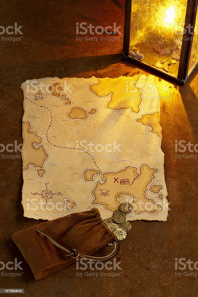 Pirate Treasure Map and Gold Coins. Full Frame, Vertical. stock photo