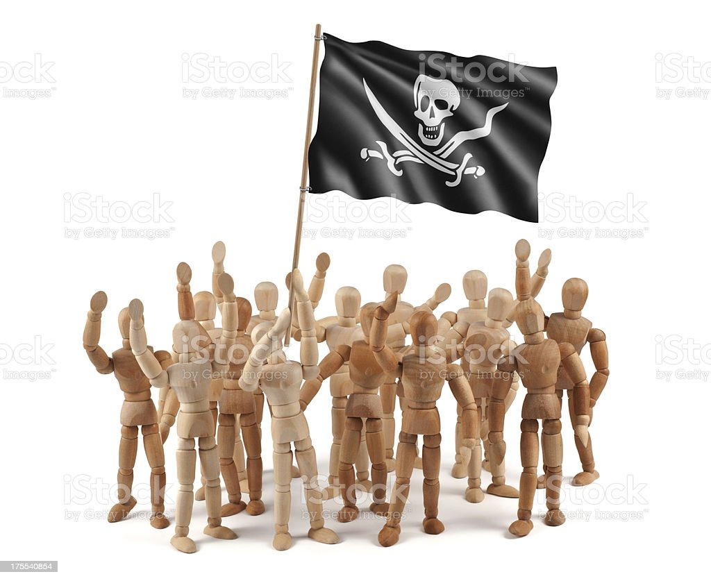 Pirate! Wooden mannequin group with flag stock photo