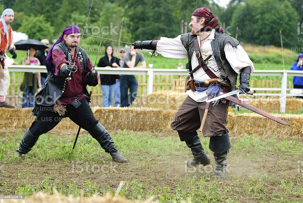 Pirates Engaged in Vicious Sword Fight stock photo