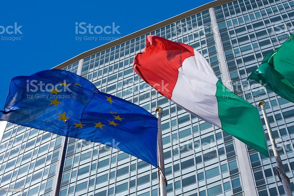 Pirellone skyscraper in Milan with Italian and European flags royalty-free stock photo