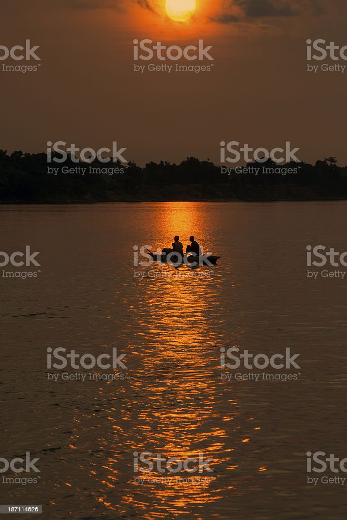 Pirogue (dugout canoe) at sunset, Congo river royalty-free stock photo