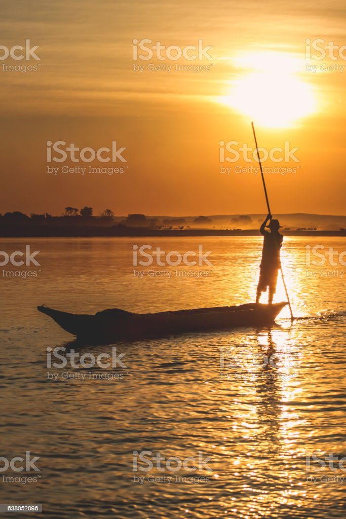 Pirogue at sunset stock photo