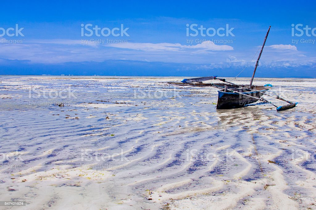Pirogue stucked on low tide on Coral reef stock photo