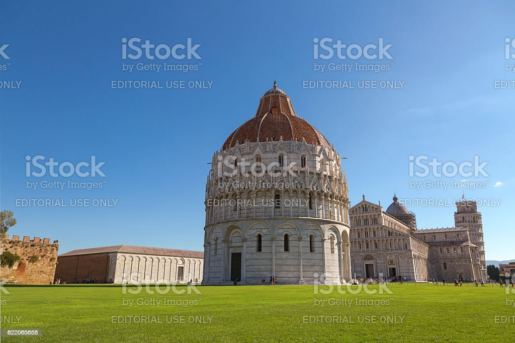 Pisa Baptistery of St. John with Pisa tower in background stock photo