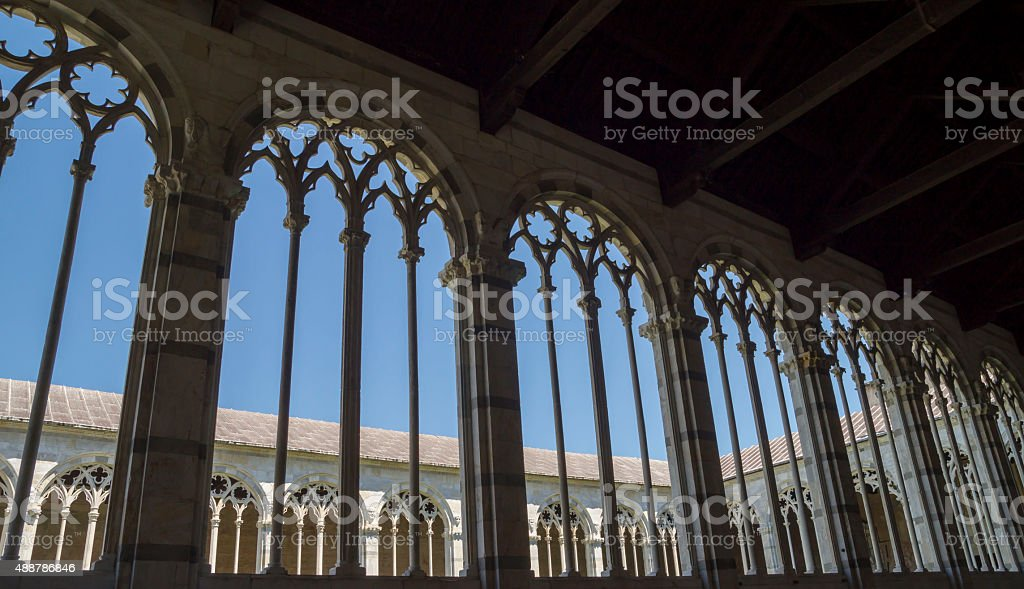 Pisa - gothic windows in  the monumental cemetery. stock photo