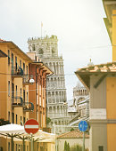 Pisa street and Leaning Tower on sunny day