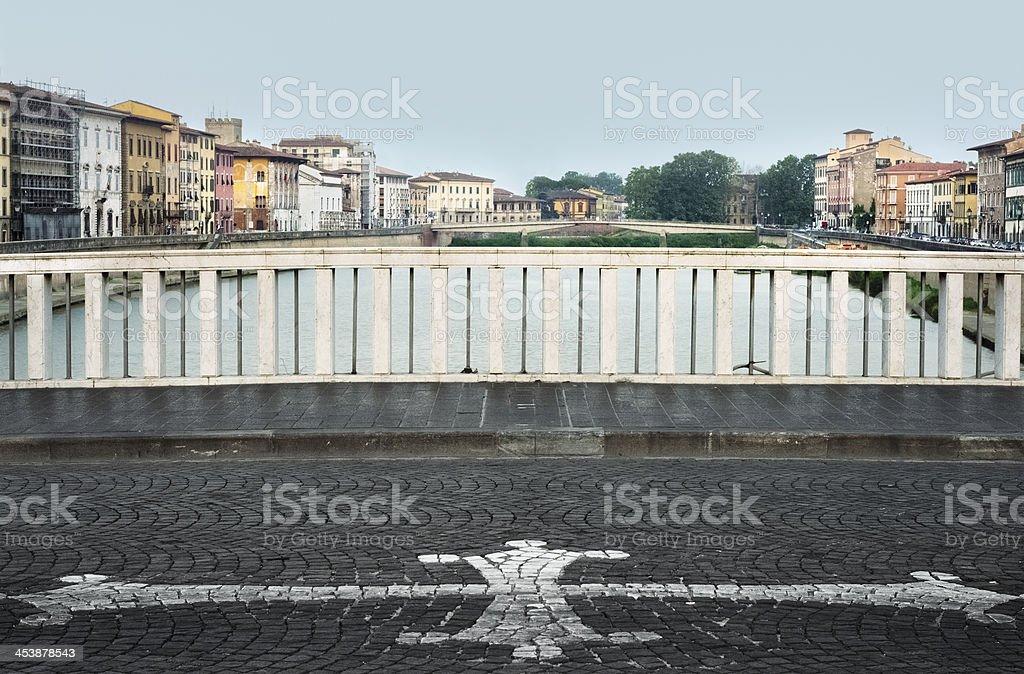 Pisa, view from Ponte di Mezzo with city symbol stock photo