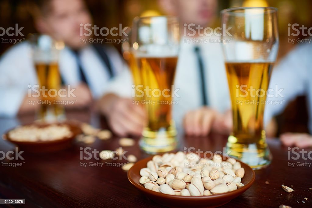 Pistachio and beer stock photo