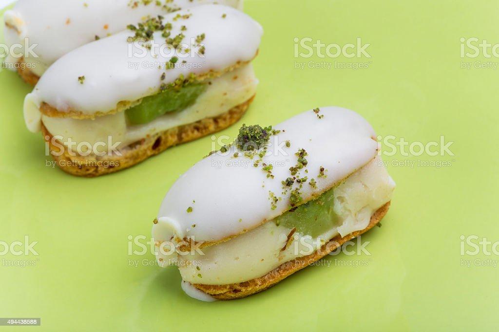 pistachio eclair kiwi stock photo