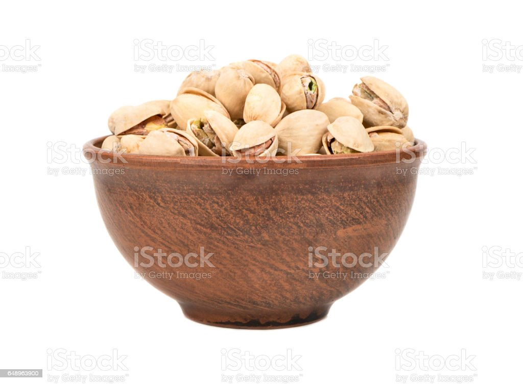 Pistachio nuts in a bowl stock photo
