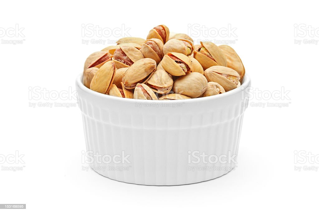 Pistachio nuts in a porcelain bowl royalty-free stock photo