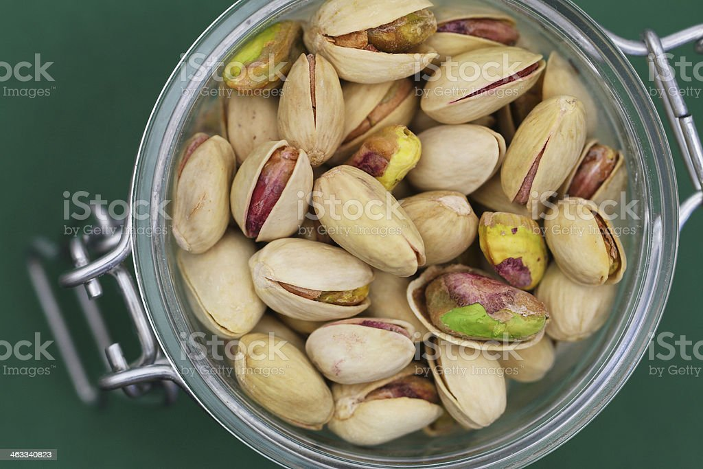 Pistachio nuts in vintage jar, close up royalty-free stock photo