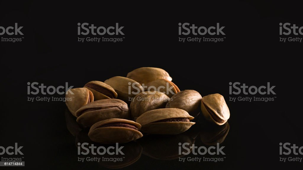 Pistachio nuts on a black background. stock photo